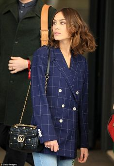 Designer: The fashionista wore a black over-the-shoulder Gucci bag embellished with gold detailing