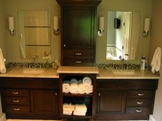 Bathroom Cabinets - I like the design... central cabinet and open shelves for towels.  Maybe not raised...?