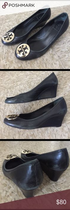 Used Black Tory Burch Sally Wedges Size 8 Pre-loved Tory Burch Sally Wedges - lots of wear but also lots of life left in them. There are faded spots on the leather that can be hidden when wearing pants. See pics for details. Gold plated Tory Burch logos on each shoe. Heel height is 2.5 inches. Feel free to make an offer! Tory Burch Shoes Wedges