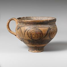 Terracotta hemispherical cup Period: Late Minoan I Date: ca. 1600–1450 B.C. Culture: Minoan Medium: Terracotta; Fine painted ware