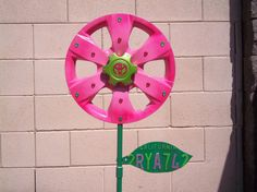 Repurposed Toyota Hubcap Flower Garden  Art  Pink and by HubCrafts
