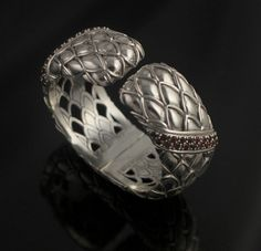 "Wide pineapple bracelet 127.3 grams sterling silver,1-1/8"" wide cuff,Two diagonal bands of  pave  gemstones,   Back hinge    Medium/average wrist"