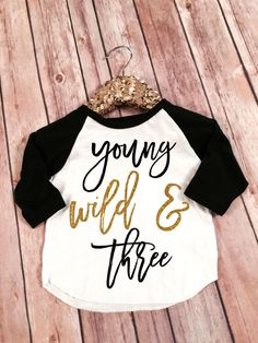 So cute for when Norah turns 3 Young Wild and Three Birthday Girl Black and Gold Sparkle Raglan Shirt, Baby Raglan Tee,Toddler Raglan Tee,Childrens Raglan tee, Birthday by SnowSew on Etsy https://www.etsy.com/listing/264043045/young-wild-and-three-birthday-girl-black