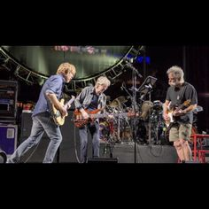 """Trey Anastasio, Phil Lesh and Bob Weir perform as part of the Grateful Dead's """"Fare Thee Well"""" tour on Saturday in Santa Clara, Calif.  Night 2 in Santa Clara is scheduled for 6PM PST tonight. Check the link in our bio for all streaming options. ( by Jay Blakesberg / Courtesy of the Grateful Dead) #gratefuldead #gd50 #treyanastasio #phillesh #bobweir #faretheewell #liveandlisten"""
