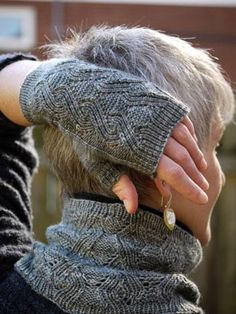 Classic architectural detail sets off this fingerless mitt and neckwarmer set in two sizes (S/L), to knit in fine, soft sock yarn. The mitts are sculpted to fit like a second skin, while the neckwarmer is relaxed. The seemingly complex cable pattern is a surprisingly simple motif. Substituting yarn and/or needles may result in an overall variation in size.The sample shown was knit in Dirty Water Dyeworks Bertha, shade Smoke.See the curling film on the knitspot youTube channel