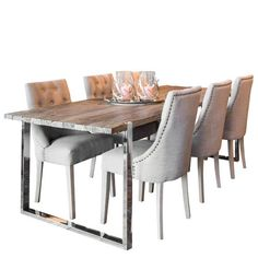 Handcrafted elm dining table is perfect to make a statement. Stunning wooden table with stainless steel base, looks great with modern dining room furniture. Shop the industrial dining table with free UK delivery! Wooden Dining Set, Reclaimed Wood Dining Table, Industrial Dining, Solid Wood Dining Table, Extendable Dining Table, Dining Sets, Industrial Chic, Fabric Dining Chairs, Dining Table Chairs