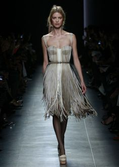 This Bottega Veneta fringe dress caught our attention for the way it played on the idea of a grass skirt. #bottega_veneta #dresses