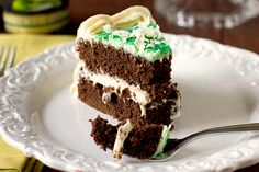 Guinness Chocolate Cake with Baileys Irish Cream Cheese Frosting by the browneyedbaker.....ummmm, YUMMMM!