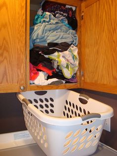It would be awesome to have your laundry shoot go down into a cabinet -- like this-- VIOLA hidden laundry mess ;)