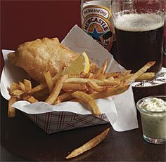 This is the iconic, beloved, comfort food of England: crispy cod or haddock and crunchy French fries with the traditional accompaniments of creamy, briny tartar sauce and malt vinegar. In the classic manner, the chips are fried twice: first blanched at a low temperature to cook the potatoes through, then fried at a higher temperature to give them their crisp, golden-brown exterior. Serves 4