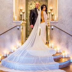 Happy anniversary to this beautiful couple, Natalie Eva Marie & Jonathan Coyle. We are  wishing you the very best . Dress by Michael Costello. Email Jenny@shopcostello.com for custom order info