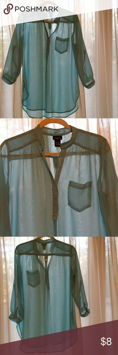 Very Pretty Rue 21 Sheer Blouse. Size Large. Pretty and feminine aquaish/greenish/bluish blouse by Rue 21. In good used condition. No holes or stains but I see one small pull. Zoom in on picture 3. It's not bad at all,  as you can see. It has 3/4 length sleeves and it has buttons on the sides of the sleeves so they can be rolled and buttoned if you want. Size Lg. Rue 21 Tops
