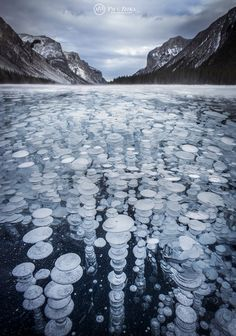 Flash frozen fine methane bubbles, Lake Minnewanka, Banff National Park, Alberta, Canada (photo: Paul Zizka)