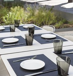 Chilewich placemats create a sophisticated outdoor dining tablescape at the restaurant Untitled at the Whitney Museum.