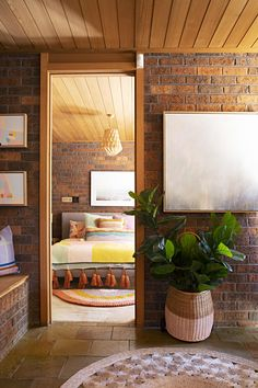 Colorful Australian Art Enlivens This All-Brick '80s House: gallery image 2