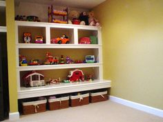 I have got to find a way to get toys off the floor in the new basement playroom. Cute idea...