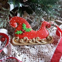 Sleigh, red and white polka dot, candy-cane trim, bright gold runners by Teri Pringle Wood
