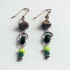 Green beads both glass and ceramic connected with hoops to the silver pagoda above. An earrings with great movement on sterling French wires.