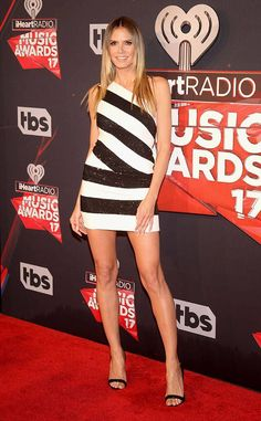 Heidi Klum from iHeartRadio Music Awards 2017: Red Carpet Arrivals  Never one to miss turning a red carpet into a catwalk, the supermodel looks lovely in a black and white striped mini-dress.