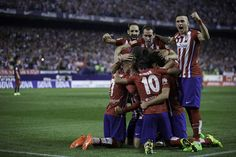 Fernando Torres (2ndL) of Atletico de Madrid celebrates scoring their opening goal with teammates during the La Liga match between Club Atletico de Madrid and FC Barcelona at Vicente Calderon Stadium on September 12, 2015 in Madrid, Spain.