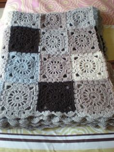 crochet blanket - loving the blue with the   creams and gray. Just taught myself how to crochet granny squares so I can piece   them together like this. :)