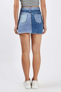The denim skirt is everything right now. This MOTO style is crafted from a washed patch work denim, and features a raw hemline for a current feel. Sitting high on the waist, it comes detailed with a zip and button fastening with practical side pockets. #Topshop