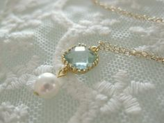 Really pretty glass necklace. Matches my engagement ring! beadpod8 on Etsy.