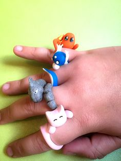These super cute wrap around rings are handcrafted to be shaped like any of your favorite companions! There's a reason why you have so many fingers – to collect em' all and become a Pokemon Master of course! #pokemon #nintendo #anime #kawaii #rings #merchandise