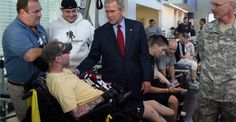 George W. Bush visits with Army Sgt. Nicholas McCoy at the Center for the Intrepid at Brooke Army Medical Center in San Antonio. (Photo: John Davenport/ZUMAPress/Newscom)