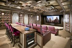 #HomeTheater with a bar. | Let us design and install one for you. | www.hitechhome.net