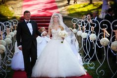 The Couple Make Their Way Down the Aisle After The Ceremony The Couple Make Their Way Down the Aisle After The Ceremony bride groom ceremony flowers wedding gown decor mens wear aisle white outdoors countryside Alain Martinez