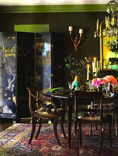 Green velvet upholstered dining room; crown molding painted green, eclectic interior, antiques
