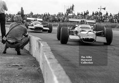 A film cameraman gets up close as Graham Hill, Gold Leaf Team Lotus Cosworth 49B, leads Jo Siffert, Rob Walker Lotus 49B, at Copse Corner, Silverstone, 1969 British Grand Prix. #f1 #formula1