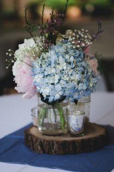 reception venue table centerpiece decoration flowers blue pink