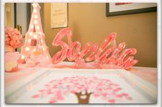 Sign in table, Eiffel Tower by Lollipop Lights.