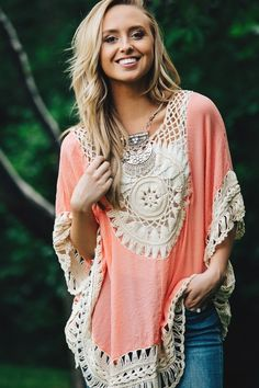"""You will not want to take this Summer Crochet Boho Tunic off! Made of a light, gauzy fabric, and featuring darling crochet detail, this top is both eye-catching & comfortable! Throw it over your swimsuit & head to the beach, wear it casually with cut-off's, or wear it out with some skinnies and statement earrings! SIZES (Runs true to Size)Small fits 0-4Medium fits 6-8Large fits 10-12Models pictured are 5' 4"""" - 5' 9"""" & are wearing a Size Small."""