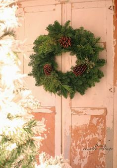 Look how beautiful this natural wreath is against the rustic and chippy pink! love, Love, LOVE! From FRENCH COUNTRY COTTAGE: Simple Christmas Wreaths
