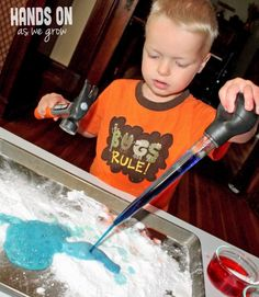A baking soda and vinegar experiment with added color for more fun