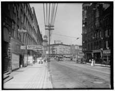 Monroe Street, now Monroe Center. Rosa Parks Circle and Wege Plaza is on the left, PNC Bank replaced the building with the clock tower, the Amway Grand and Pantlind replaced Sweet's in the middle and McKay Tower is now on the right. - c. 1910.