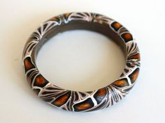 Copper, black and white bangle bracelet. Abstract pattern, deep pools of rich metallic colour. Unique one-of-a-kind piece by DoodlePippin