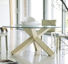 bellini la rotonda table - Mario Bellini - A unique mortise joint assembly supports this round dining or conference table. The bevel-edge glass top completes the elegant presentation. Furniture Dining Table, Dining Table Legs, Dining Table Design, Kitchen Tables, Glass Round Dining Table, Glass Table, Round Glass, Esstisch Design, Bellini