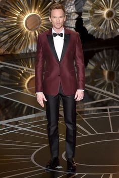 Neil Patrick Harris is striking in burgundy Valentino evening number.