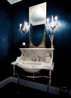 Navy blue bathroom.
