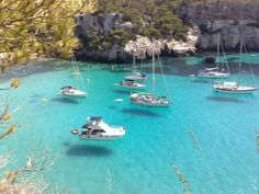 Cala Macarella, Menorca. I love how the boats seem to be suspended by an invisible thread :)