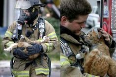 A firefighter rescues a cat from a fire. Look at those thankful eyes!