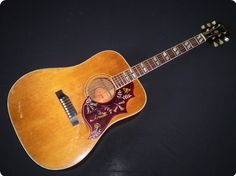 This is a great example of one of the most iconic vintage Gibson acoustic guitars - a square shouldered dreadnought with the classic vintage Gibson vibe, a beautiful bound neck with split