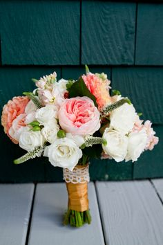 GORGEOUS peach and white bouquet!! Photo by Robin Nathan Photography, via http://theeverylastdetail.com/modern-elegant-peach-navy-maine-wedding/