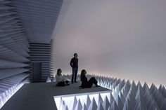 Visitors to the Doug Wheeler: PSAD Synthetic Desert III installation at the Solomon R. Guggenheim Museum, New York