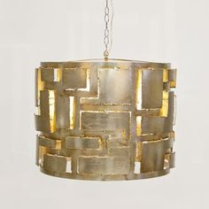 Leo Pendant Chandelier from Worlds Away in Champagne Finished Silver Leaf allows minimal light to shimmer through to highlight its shape and add weight to your room. Inserts Deco, modern and contemporary into any home. $780