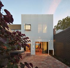 Light-filled house unveils itself at night throught its perforated metal façade